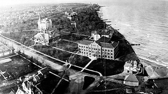 1907 - At the turn of the century, the open spaces and oak groves were more prominent than its buildings, pictured from right to left: the Life Saving Station, Fisk Hall and the Hall of Science.