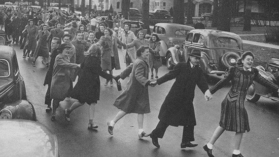 Picture of students dancing in the streets of Evanston