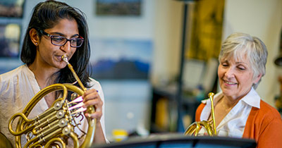 Music student playing frenchhorn