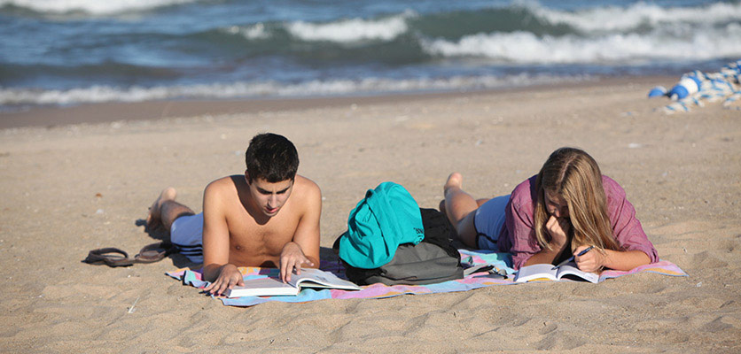 Picture of students hanging out on the beach