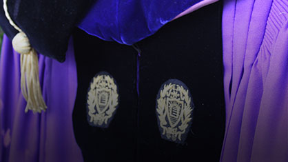 photo of a student in graduation gown