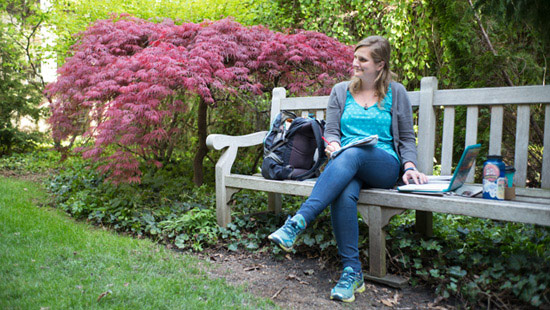 Picture of Stephanie sitting on a bench at Northwestern