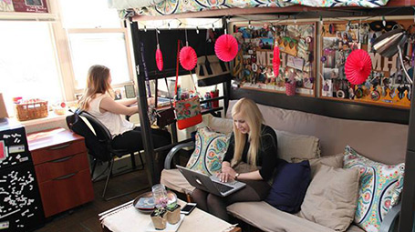 Students hanging out in their dorm room.
