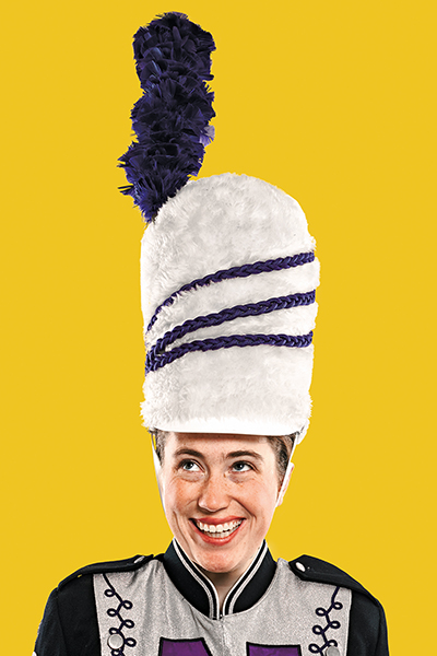 Senior Savannah Leiser Sports A Purple Plume Topped Hat And Drum Major Uniform Worn Through The 1970s