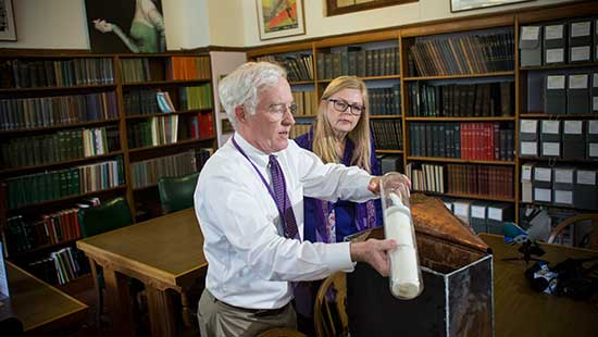 Archivist Kevin Leonard opens time capsule