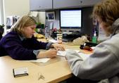 Advisor Meghan Gaseor gives feedback on paper