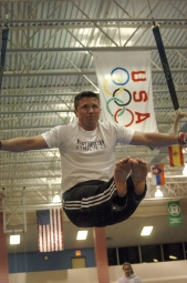 Gymnastics team founder Alex Lauder practices on the rings.
