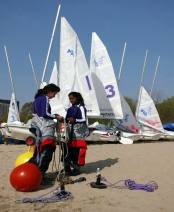 Sailing club members prepare for a home race