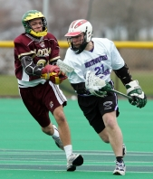 Northwestern midfielder Tim Gillard drives past a defender during a men's club lacrosse game at Northwestern.