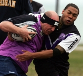 Craig Arrindell, right, a freshman rugby player, tackles an opponent from the Kellogg Rugby Football Club.