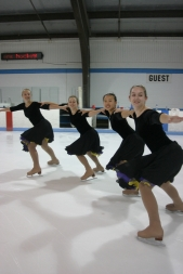 Synchronized skaters, from left to right, Lindsay Dean, Morgan Rowe, Kali Zhou and Courtney Wallace whip around the ice.
