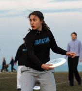 Sophomore Stacey Mosley, a member of Gung-ho, the women's ultimate Frisbee team, tosses a disc during practice.