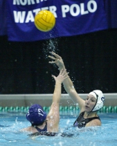 Joanna Bieri, a third-year graduate student in applied mathematics, tosses to a water polo teammate.