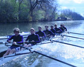 Will Defliese, first rower facing forward, and his crew teammates surge down the North Shore Channel in Evanston.