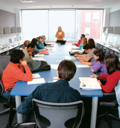 Michele Weldon (J79, GJ80), assistant professor of journalism, leads a writing class in the McCormick Tribune Center.
