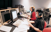 Medill students work the controls in a broadcast studio. With a growing emphasis on multimedia skills in the news industry, Medill students are encouraged to learn to produce content for audio, video and text.