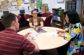 Loraine Hasebe, right, meets with Medill students Ryan Haggerty and Kim Weisensee in the Medill Career Center in Fisk Hall.