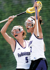 Aly Josephs (No. 5) and Sarah Albrecht celebrate the Wildcats