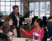 Council of One Hundred member Gail Durham Hasbrouck (L74) greets students and young alumni during the club