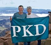 David and Pat Pokorny raise the PKD flag on Pikes Peak.