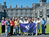 Northwestern travelers pose for a photo in the gardens of Kilkenny Castle.