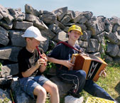 Young Irish musicians play along the path to Dún Aengus, the cliffside fortress on Inishmore.