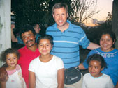 Charles Hardwick, who is fluent in Spanish, visits a family in Monjas, Guatemala, to bless their new home. He spent 10 days in Guatemala building an orphanage with a church mission group.