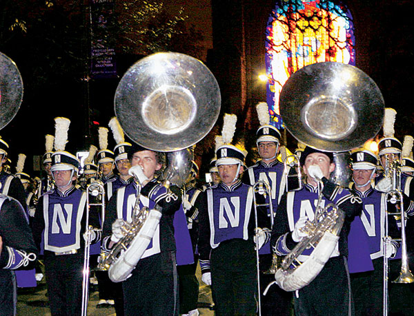 The Northwestern University Marching Band steps off on the Sheridan Road parade route.