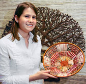 Lauren Parnell shows off a basket woven by Uganda Crafts artisans.