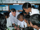 John Wood with students at the opening of Room to Read's 1,000th Reading Room, in Siem Reap, Cambodia.
