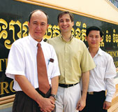 Steven Austermiller, center, with law professors Hor Peng, left, and Khim Kiri, right, at the Royal University of Law and Economics in Phnom Penh, Cambodia