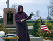 Sarah Maxwell reads the names of fallen U.S. troops at Memorial Park in Archbold, Ohio.