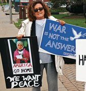 Lolly Voss protests the war in Iraq with the DeKalb (Ill.) Interfaith Network for Peace and Justice.