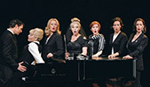 """From left to right, Tony Award-nominee Raúl Esparza, Elizabeth Stanley, Kristin Huffman, Heather Laws, Amy Justman, Leenya Rideout and Barbara Walsh perform the song """"Poor Baby"""" during a production of <em>Company</em>."""