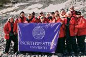 The Northwestern Alumni Association travelers show their school spirit in Antarctica.
